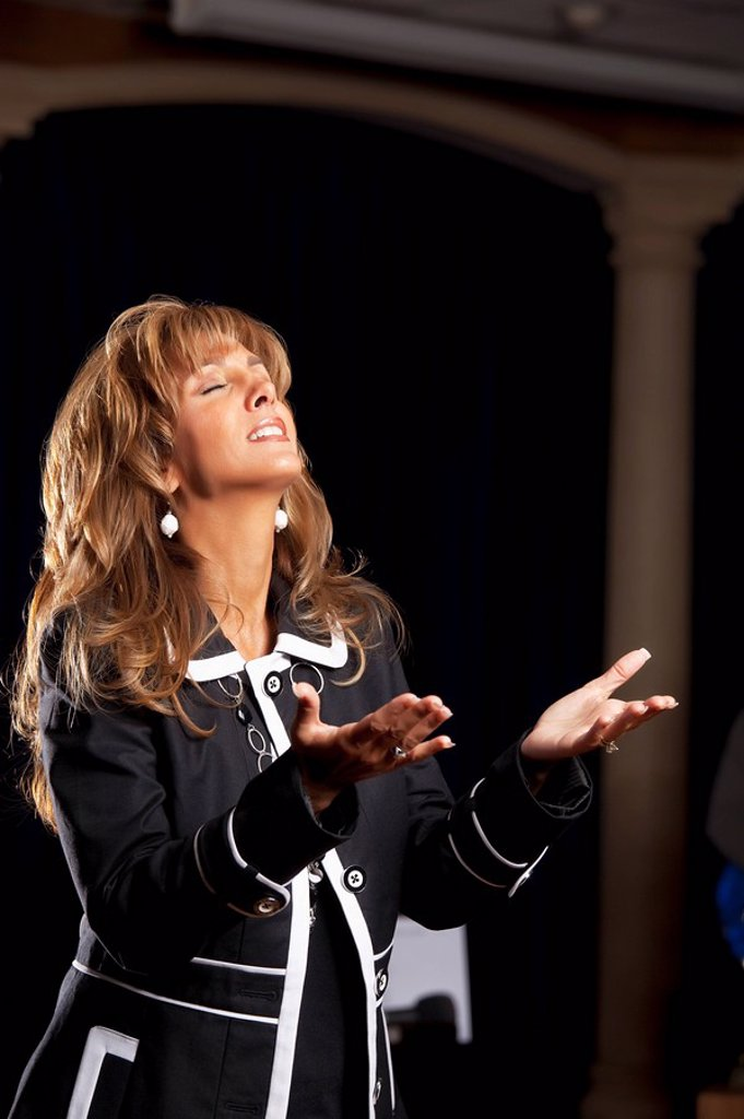 Fort Lauderdale, Florida, United States Of America, A Woman Singing With Her Hands Raised In Worship : Stock Photo