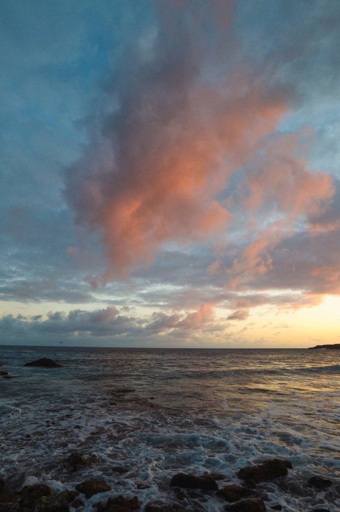 Sunset Light In The Clouds Over A Rocky Shore : Stock Photo