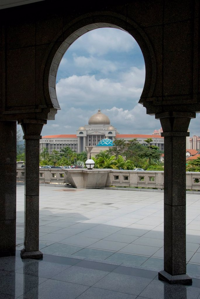 kuala lumpur, malaysia, view of a building through an archway and columns : Stock Photo