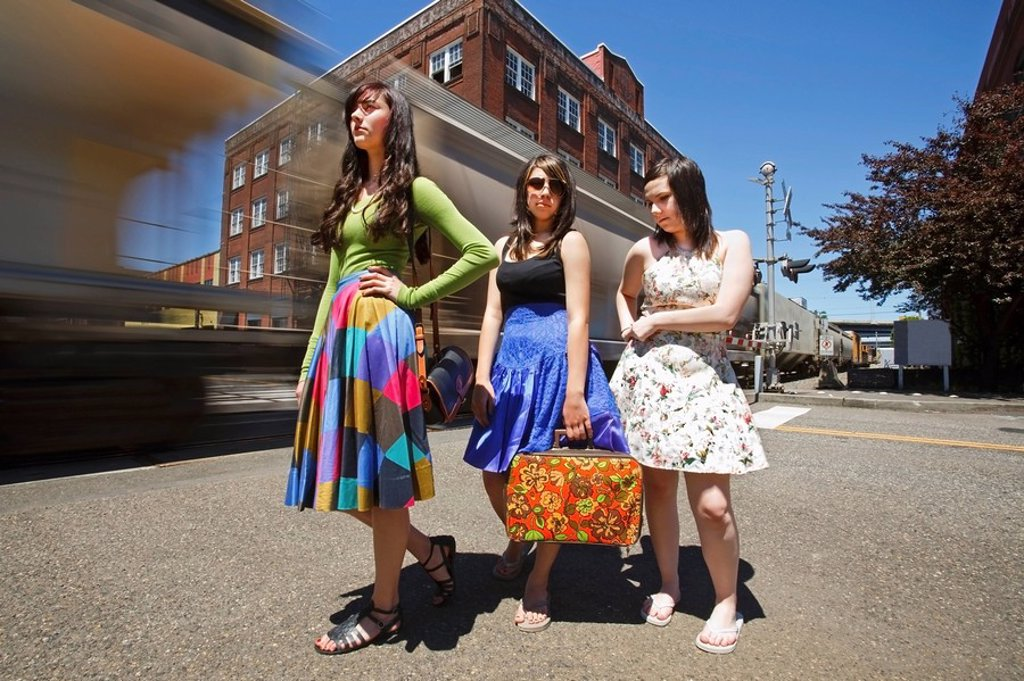 teenage girls waiting for a train in downtown, portland, oregon, united states of america : Stock Photo