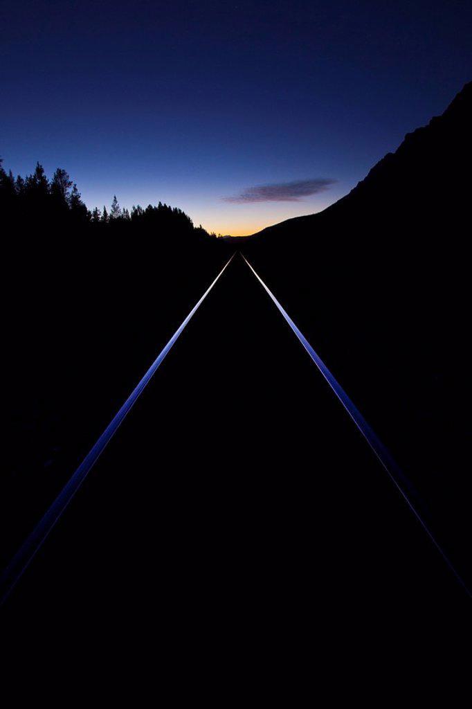 train tracks at sunset, banff, alberta, canada : Stock Photo