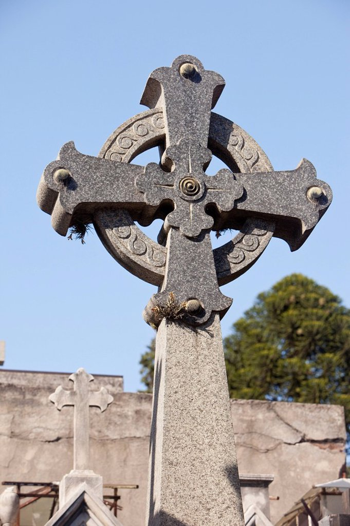 Stock Photo: 1889R-60290 Buenos Aires, Argentina, A Stone Cross On A Tomb In Recoleta Cemetery