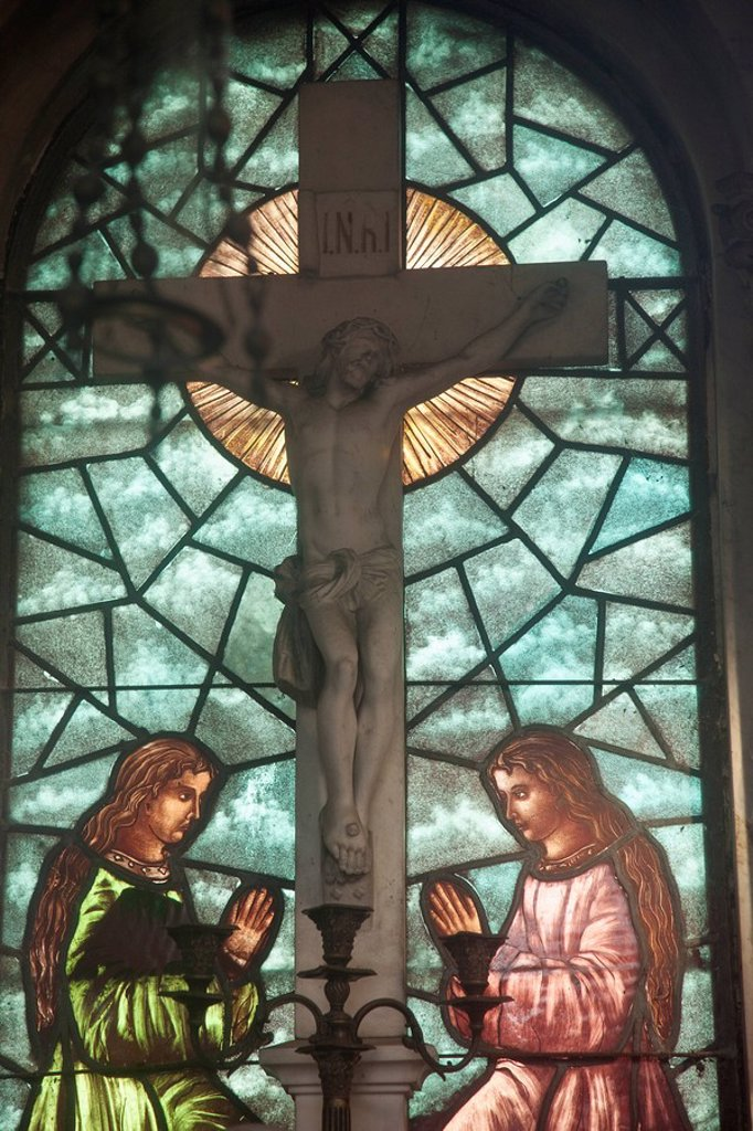 Stock Photo: 1889R-60302 Buenos Aires, Argentina, A Stained Glass Window Depicting Two Women Kneeling At The Cross In Recoleta Cemetery