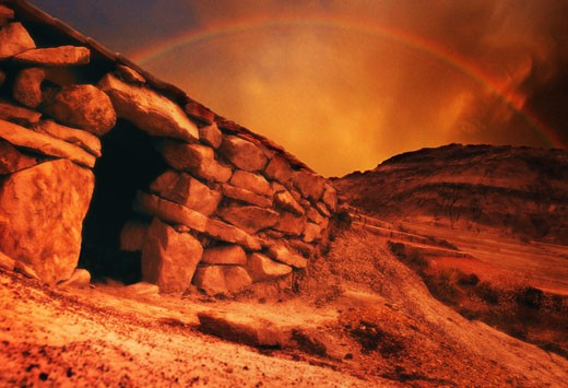 An empty tomb with a rainbow : Stock Photo