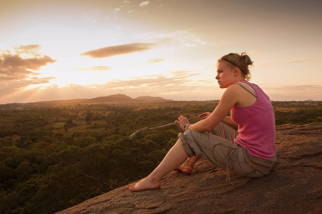 A Young Woman Looking Over The African Landscape, Manica, Mozambique, Africa : Stock Photo