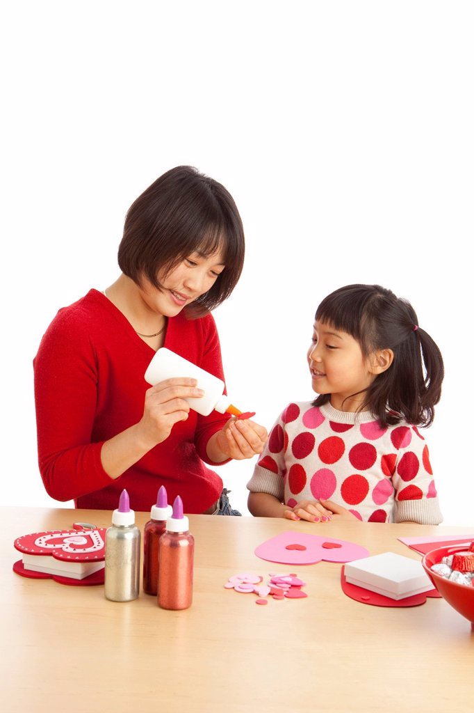 A Mother And Daughter Making Valentine´s Day Crafts : Stock Photo