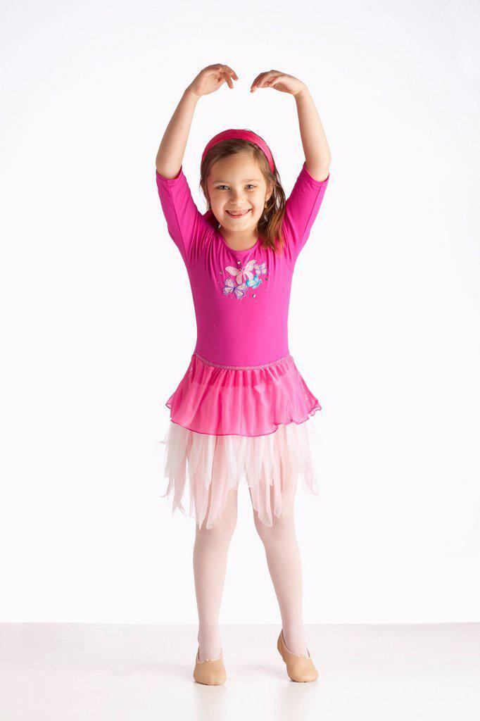 A Girl Posing As A Ballerina With Ballet Shoes : Stock Photo