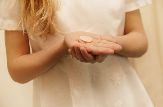 Closeup of child holding sacrament : Stock Photo