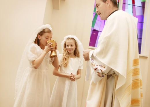 Stock Photo: 1889R-6161 Girls take their first communion