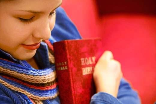 Teen holds Bible and prays : Stock Photo