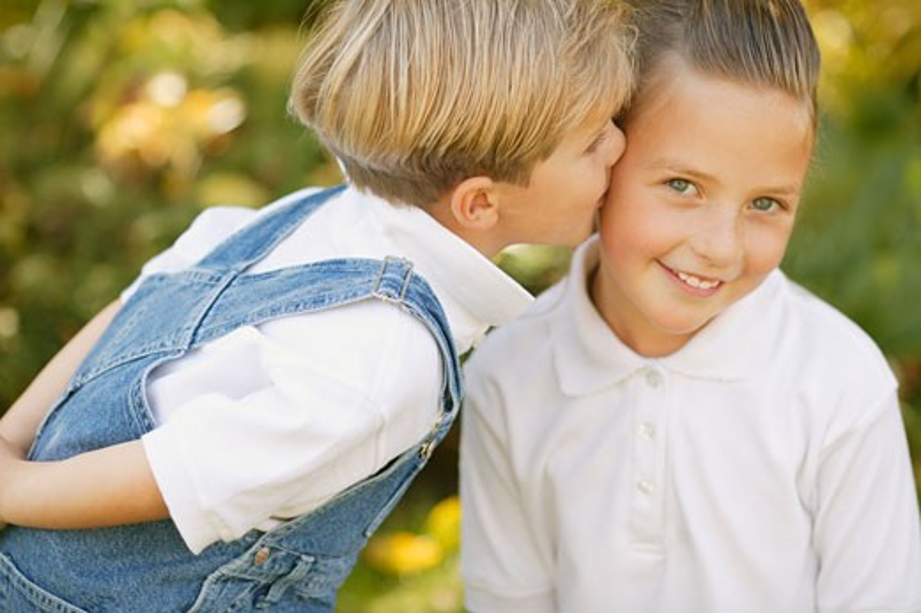 Boy kisses girl : Stock Photo