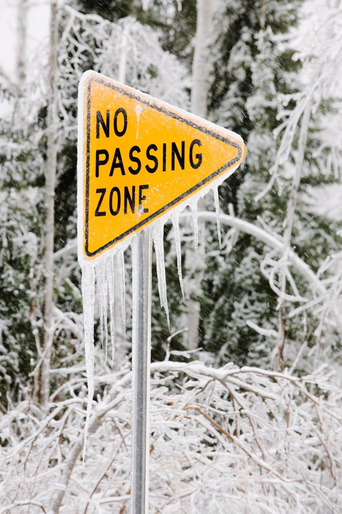 ice covered street sign that says, ´no passing zone´, minnesota, united states of america : Stock Photo