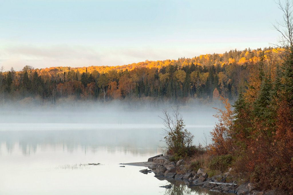 Stock Photo: 1889R-62753 mist over a lake in autumn near wawa, ontario, canada