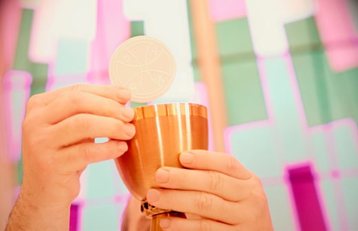 Priest holds sacraments : Stock Photo