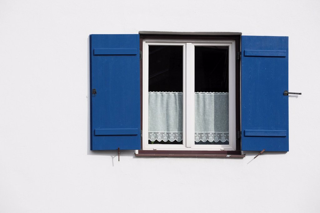 Stock Photo: 1889R-62918 bright blue shutters on a white wall with lace curtains in the window, oberstdorf, germany