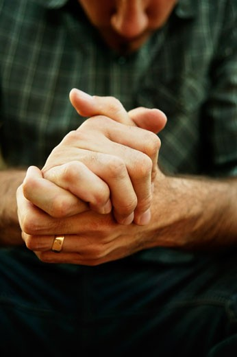 Hands folded together : Stock Photo
