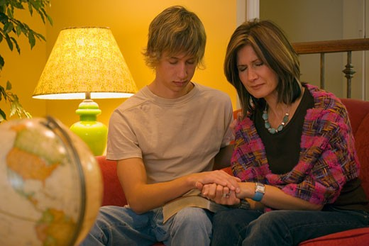 Mother and son pray together : Stock Photo