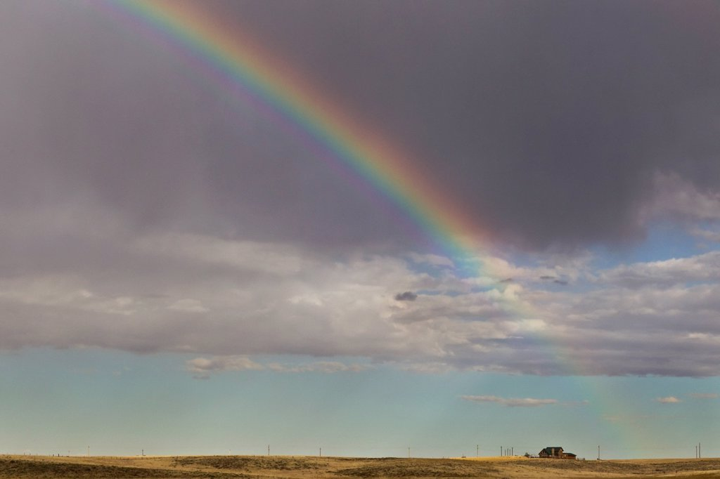 rainbow over a house on the western plains, colorado, united states of america : Stock Photo