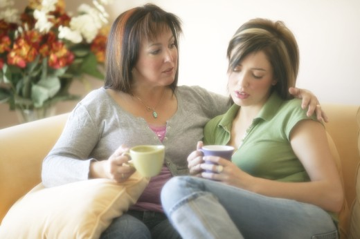 Stock Photo: 1889R-6439 Mother helping daughter