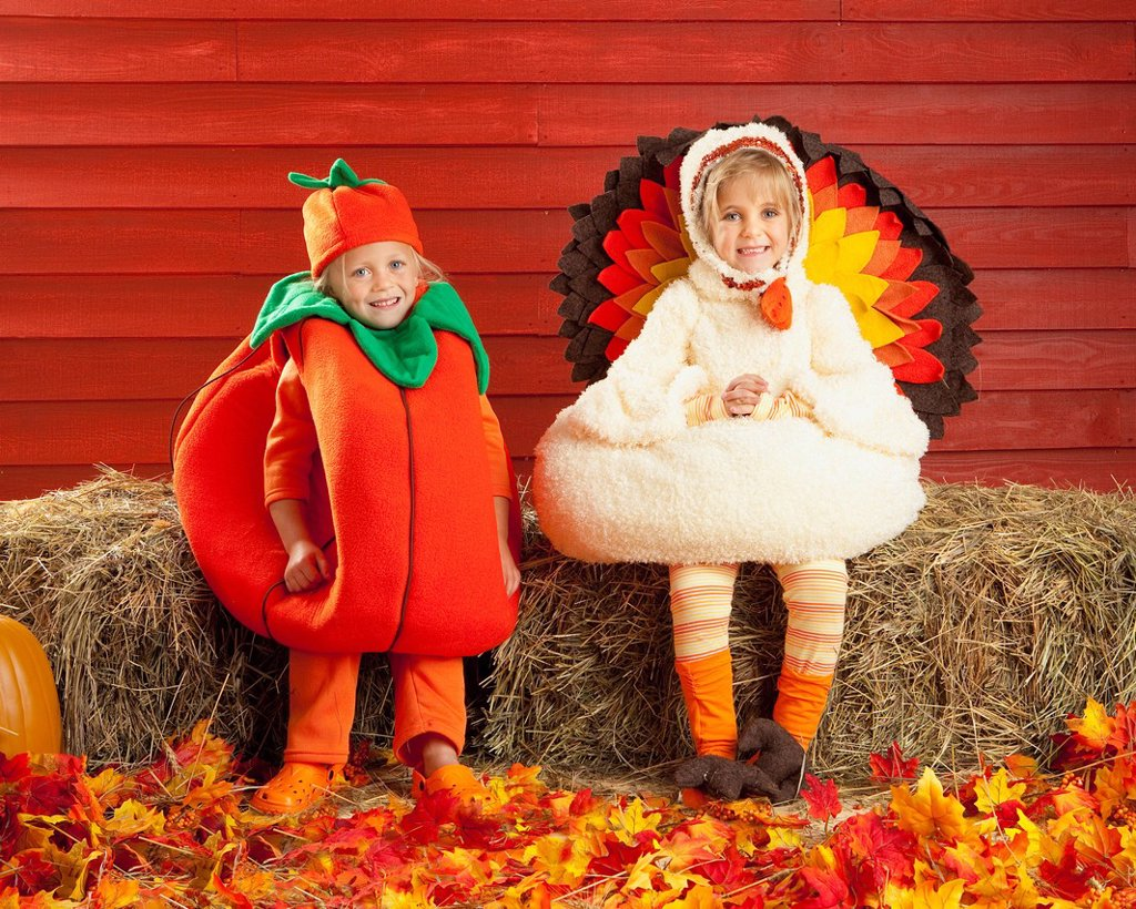 two children in costumes in autumn, three hills, alberta, canada : Stock Photo