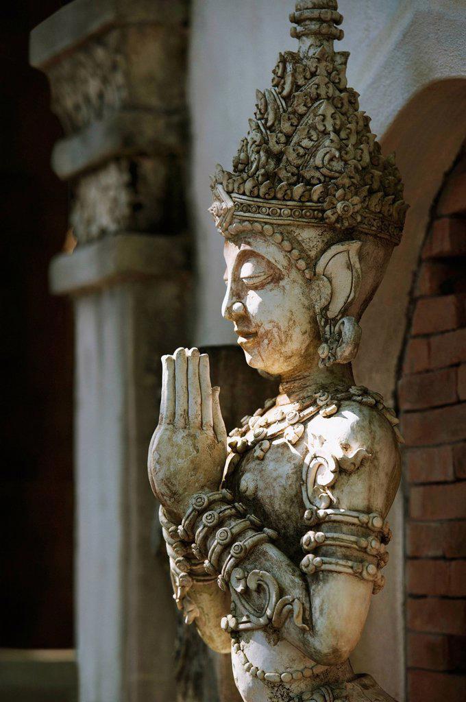 buddhist statue at mandarin oriental dhara dhevi hotel, chiang mai, thailand : Stock Photo