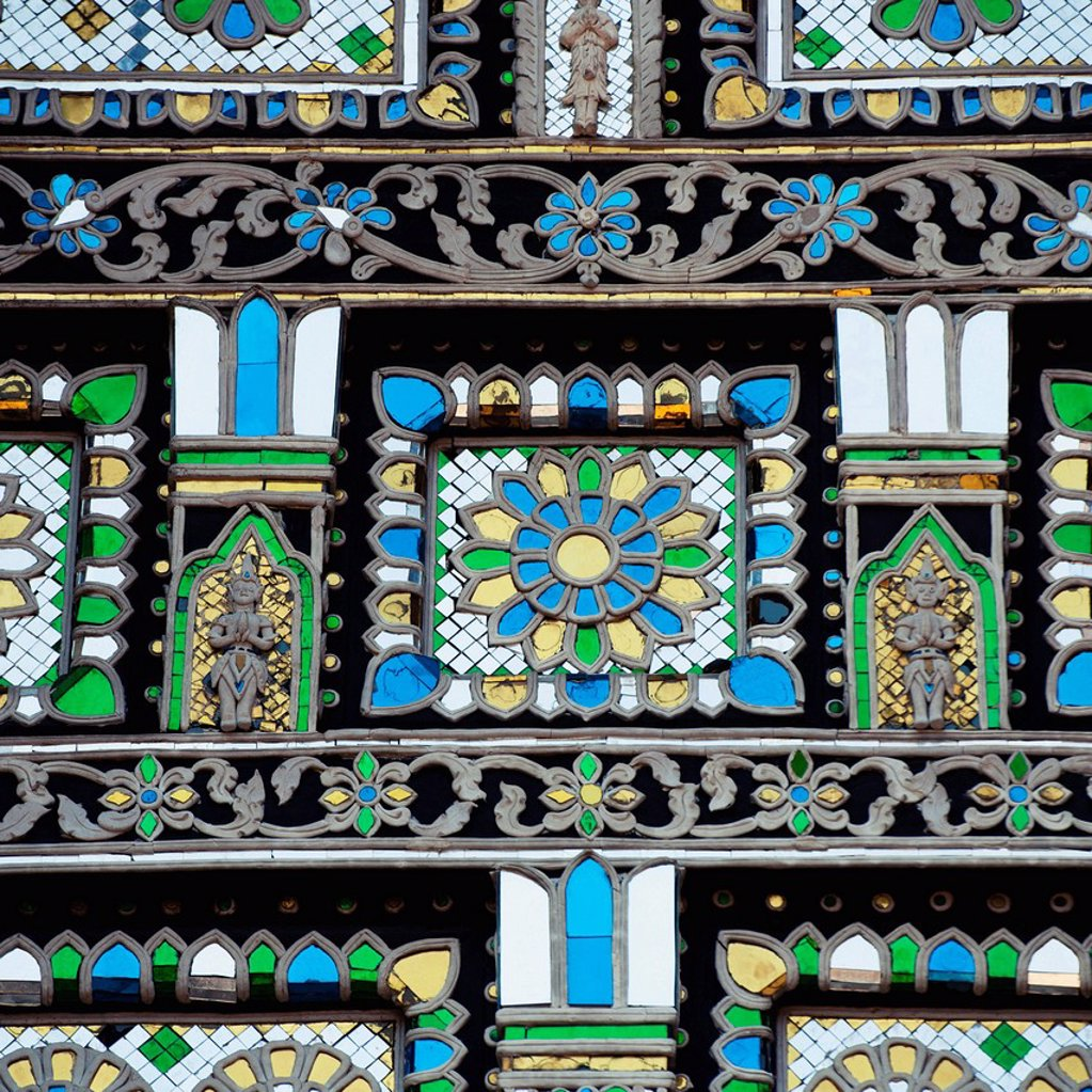 Stock Photo: 1889R-64611 an ornate mosaic of blue, yellow, white and green stone in chedi luang temple, chiang mai, thailand