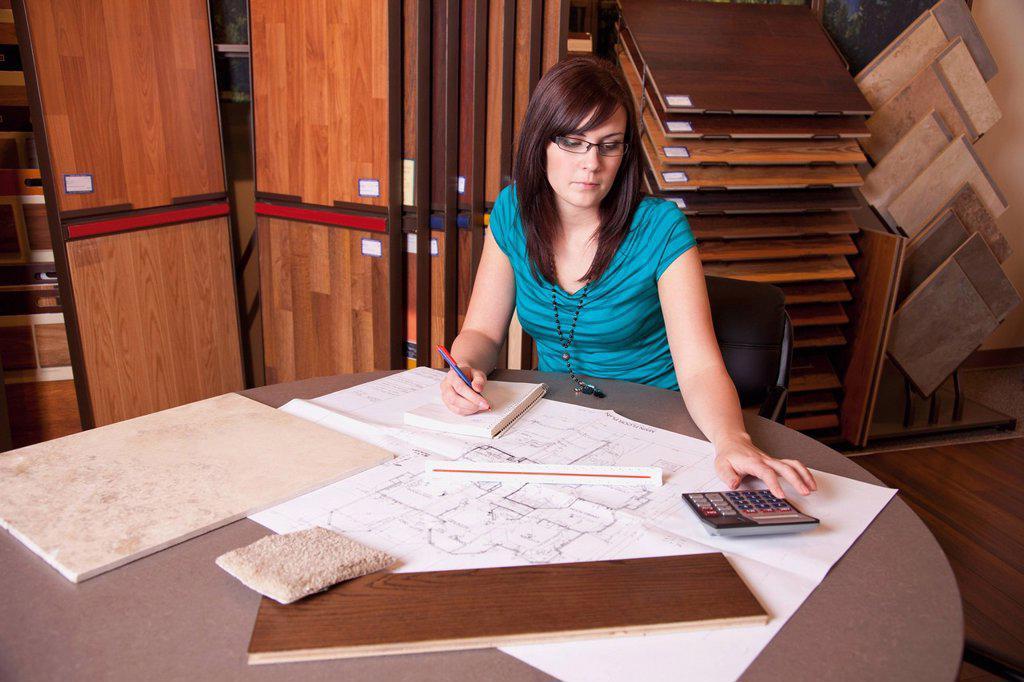 a design consultant working in a retail flooring store, edmonton, alberta, canada : Stock Photo