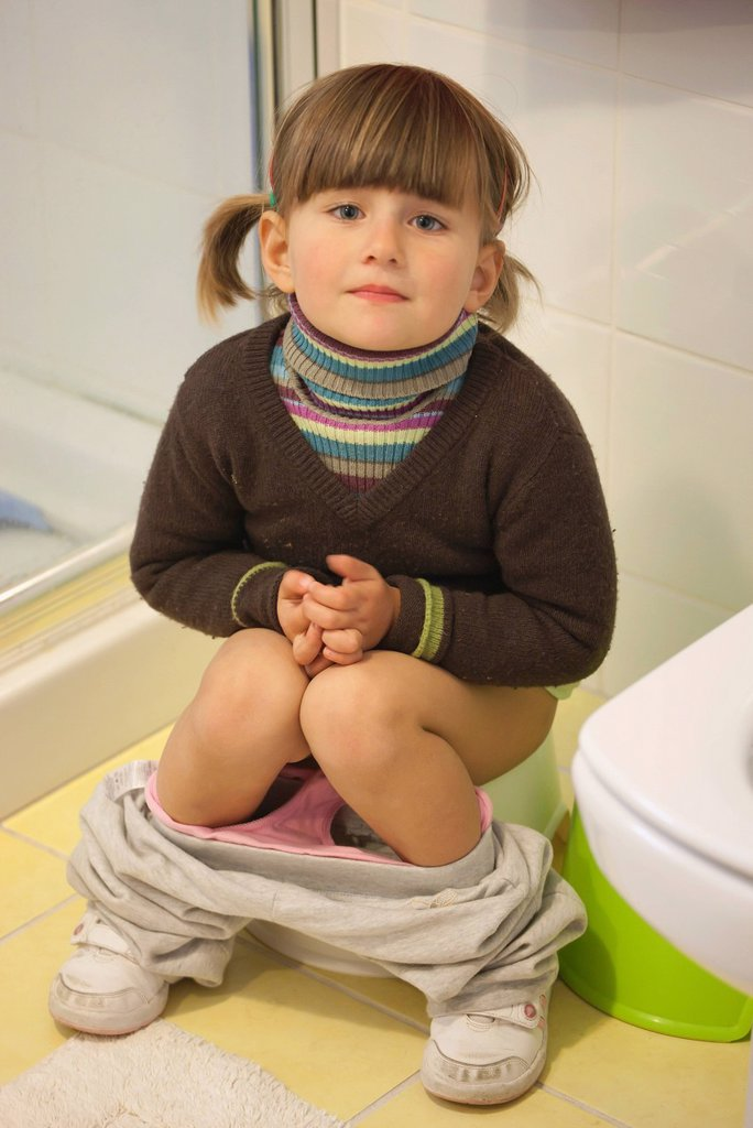 three_year_old girl toilet training, torremolinos, malaga, spain : Stock Photo