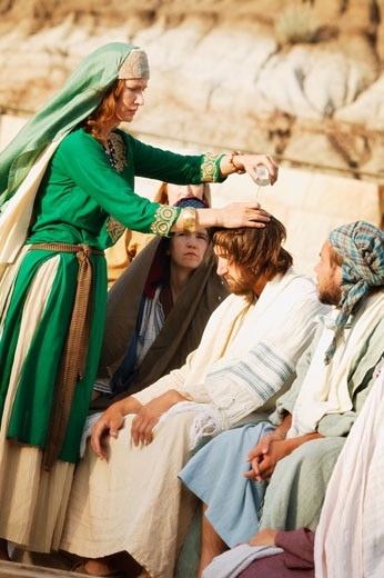 Stock Photo: 1889R-6607 Woman pours oil on Jesus' head