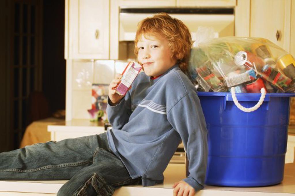 Child drinks juice box : Stock Photo