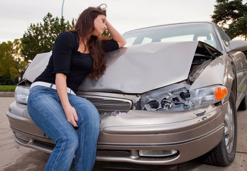 young woman with vehicle that has been in a collision, edmonton, alberta, canada : Stock Photo