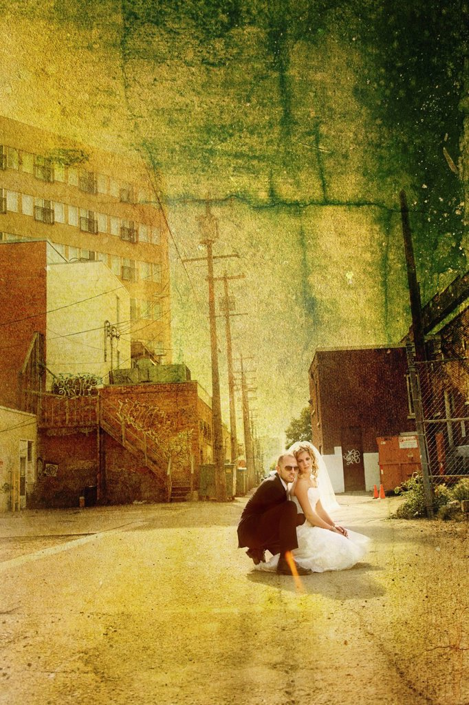 Stock Photo: 1889R-67295 a bride and groom in an urban scene