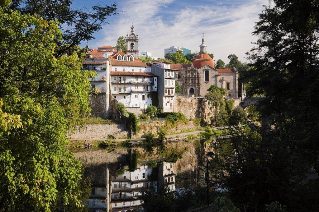 historic buildings reflected in the tamega river, amarante, portugal : Stock Photo
