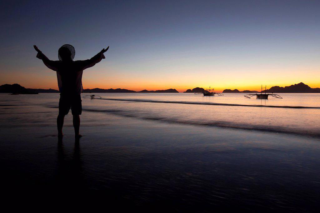 Stock Photo: 1889R-67719 a man on a beach at sunset, corong_corong, palawan, philippines