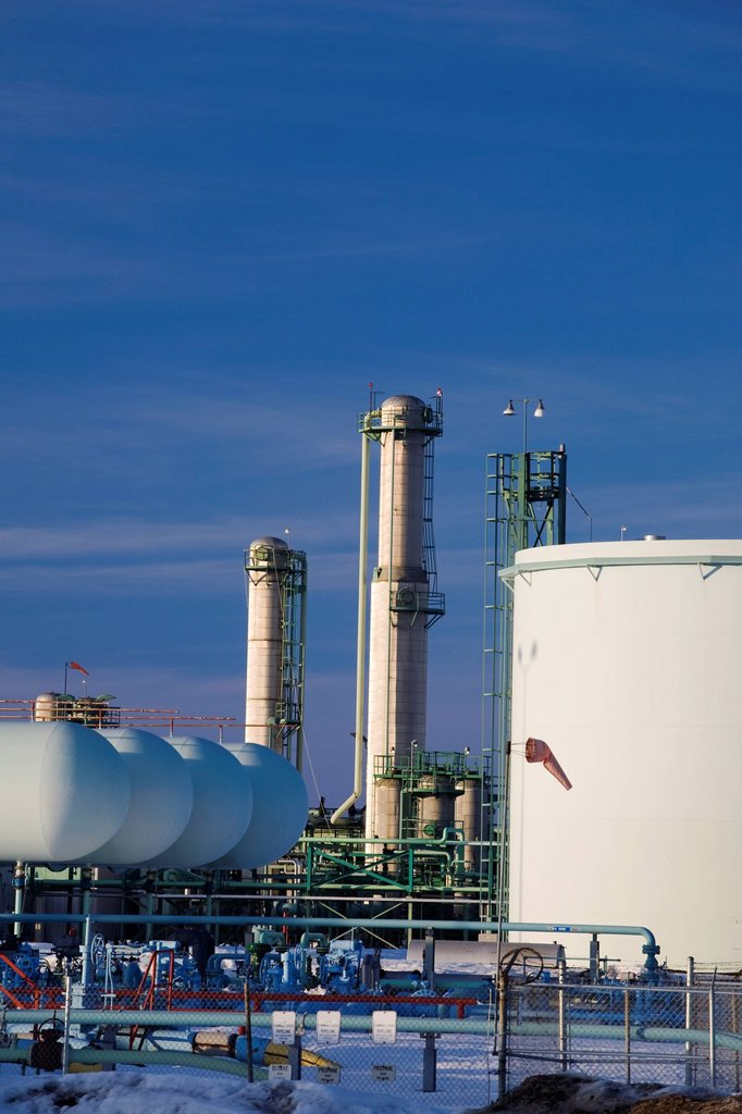 oil tanks and refinery towers in winter at sunset, fort saskatchewan, alberta, canada : Stock Photo