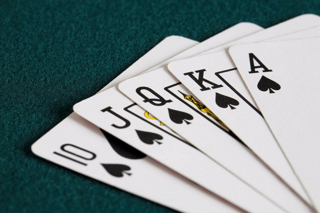close_up of blackjack playing cards showing spades royal flush : Stock Photo