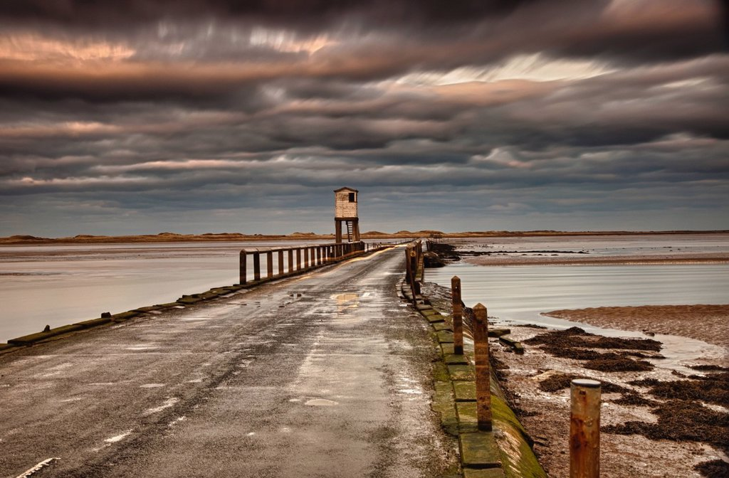 the causeway from holy island, northumberland england : Stock Photo