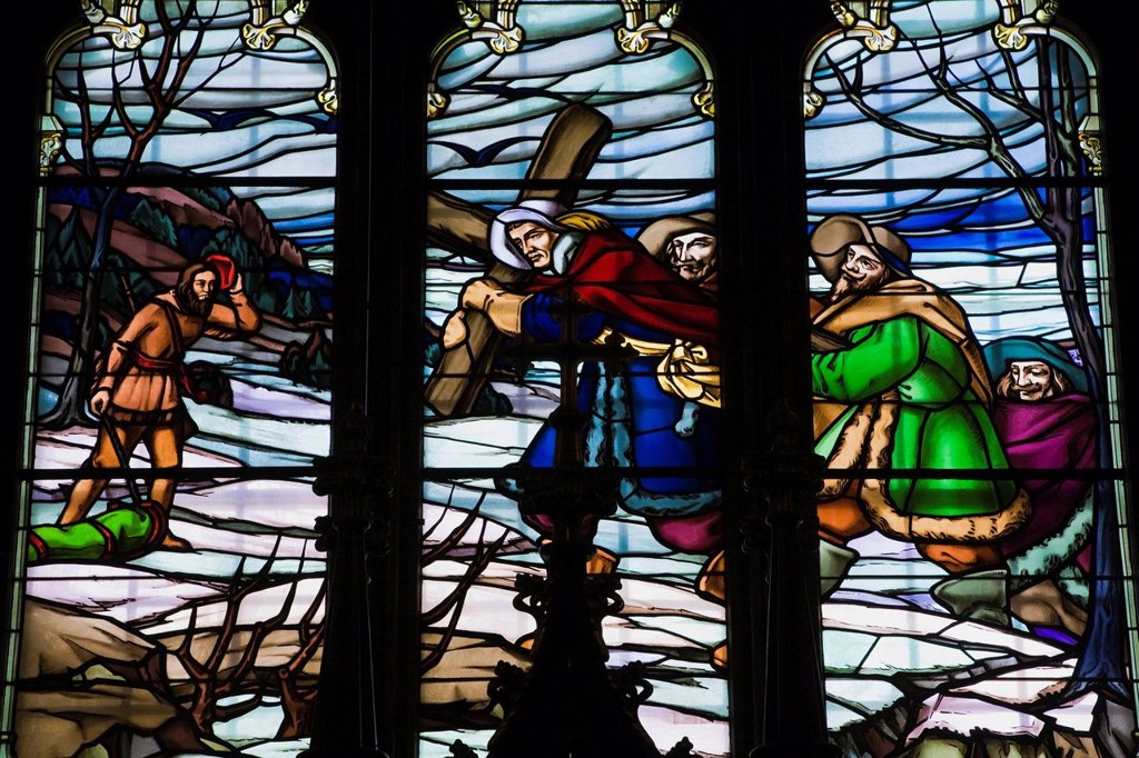 stained glass window with a religious scene in notre_dame basilica, old montreal quebec canada : Stock Photo