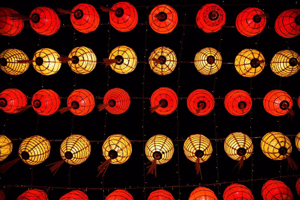 red and yellow chinese lanterns hanging from the ceiling, chiang mai thailand : Stock Photo