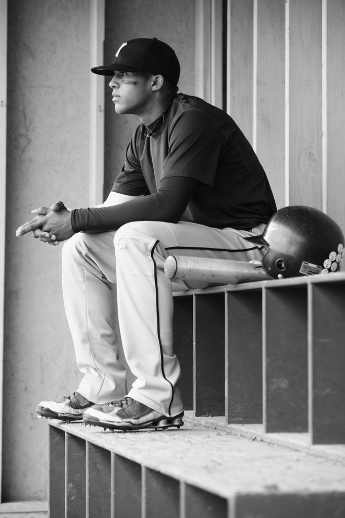 teenage boy baseball player sits watching, troutdale oregon united states of america : Stock Photo