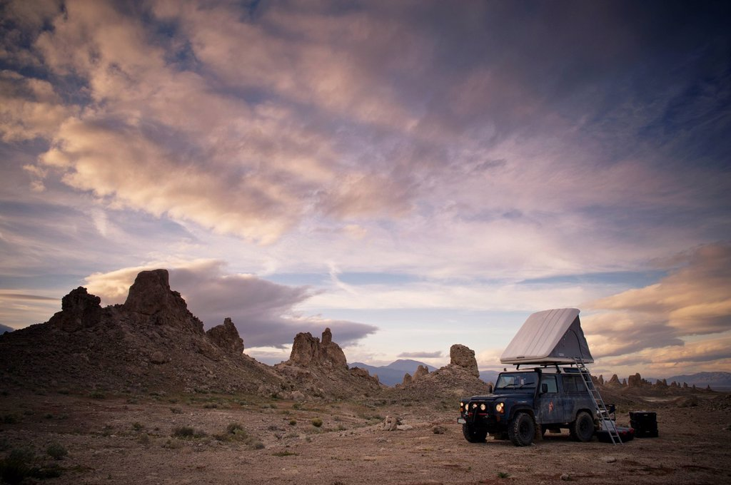Stock Photo: 1889R-69463 1983 land rover defender camped at trona pinacles, trona california united states of america