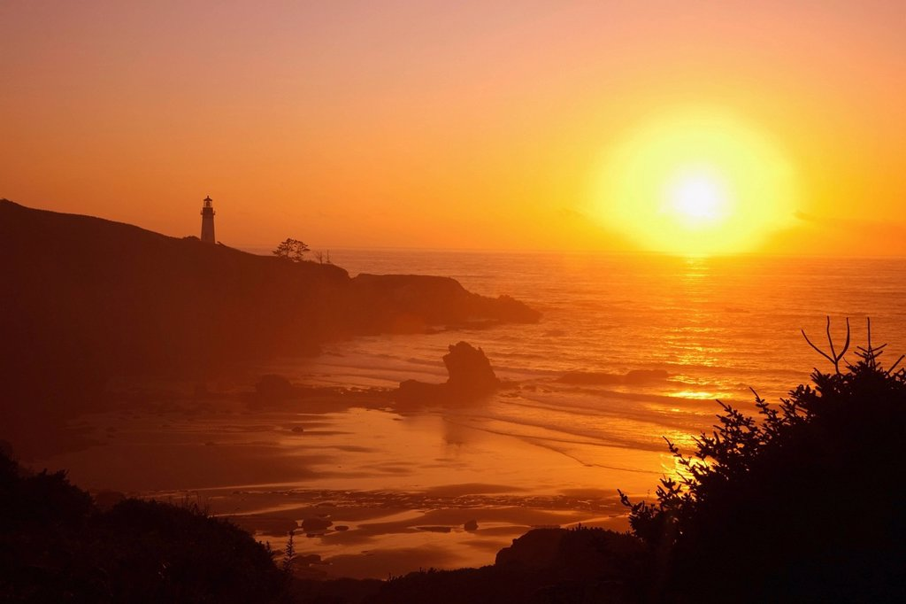 sunset over yaquina head lighthouse, newport oregon united states of america : Stock Photo