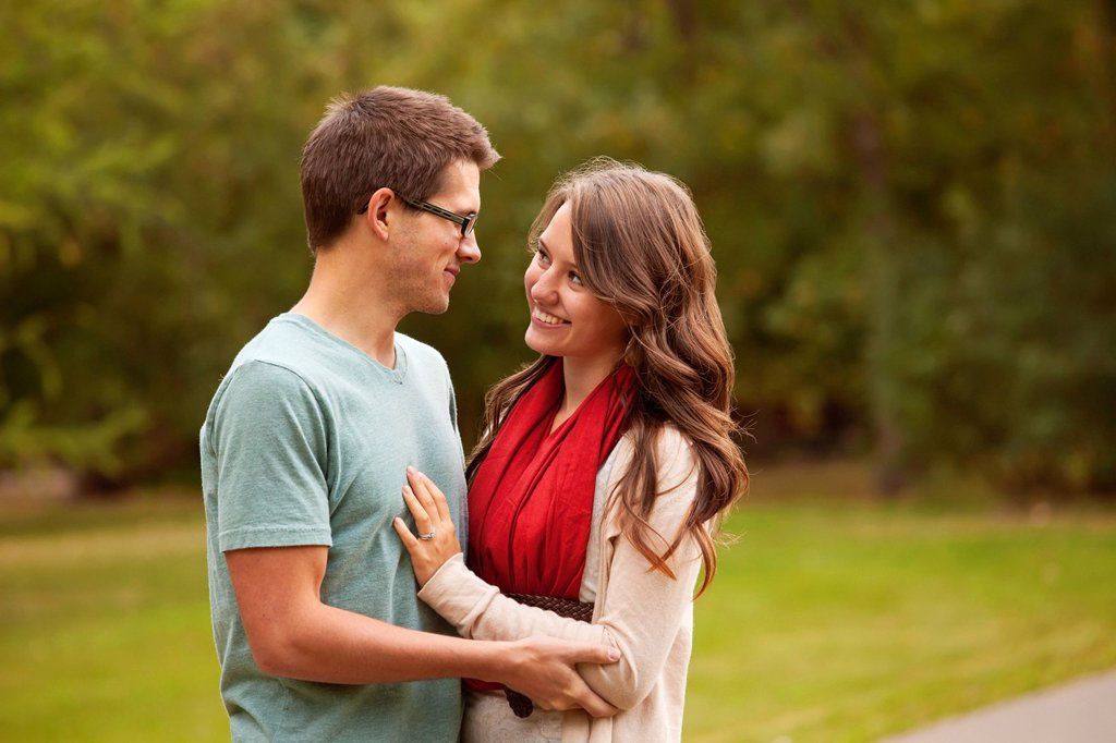 newlywed couple spending time together in a park, edmonton alberta canada : Stock Photo