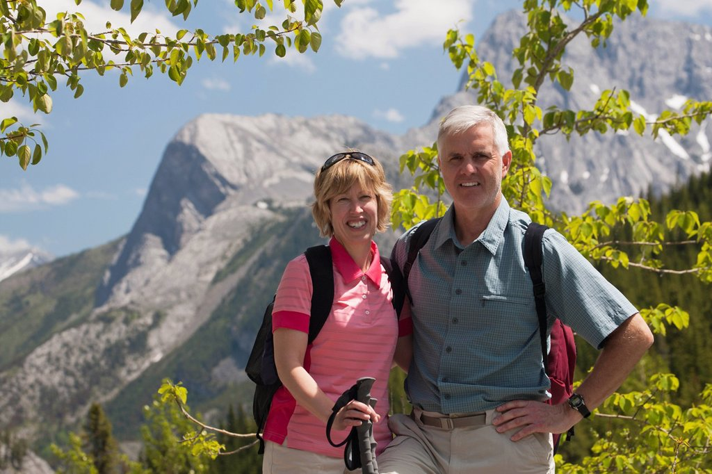 Stock Photo: 1889R-70442 a couple hiking in the mountain, alberta canada
