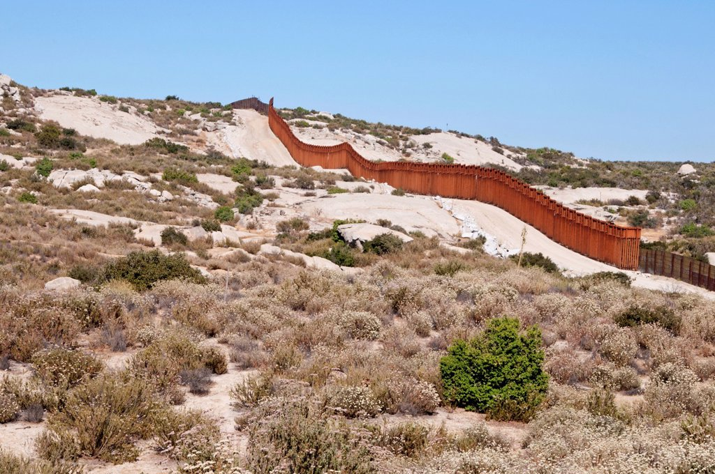 the us_mexico border fence in san diego county, campo california united states of america : Stock Photo
