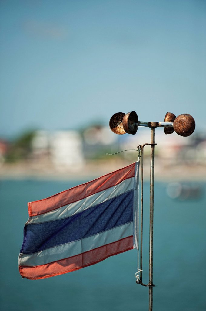 thai flag and weather vane, prachuap kiri khan prachuap province thailand : Stock Photo