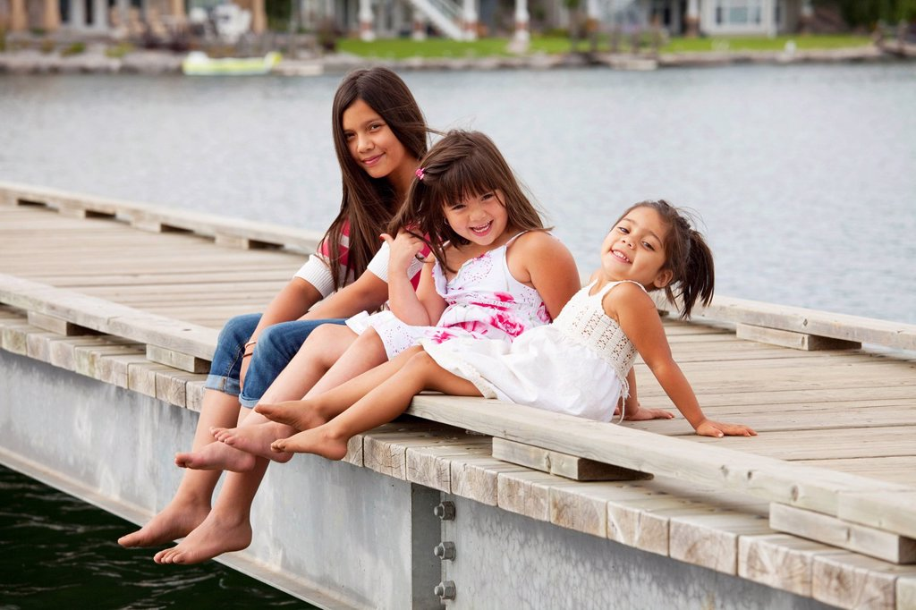 Stock Photo: 1889R-71197 three sisters on a pier at a residential lake community, edmonton alberta canada