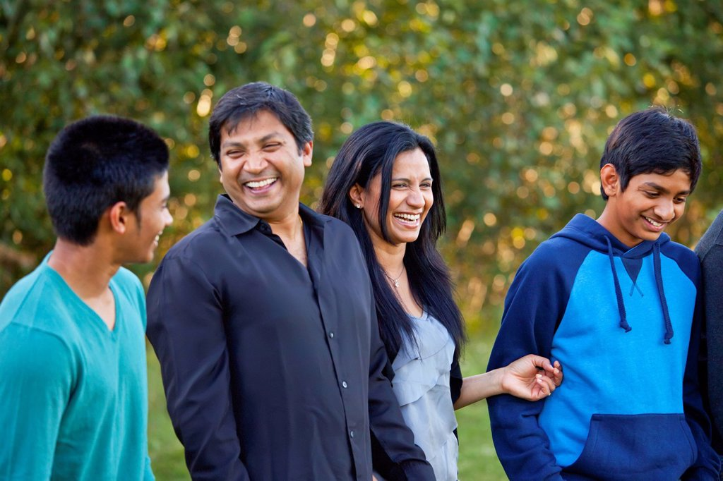 a family enjoying time together in a park, edmonton, alberta, canada : Stock Photo