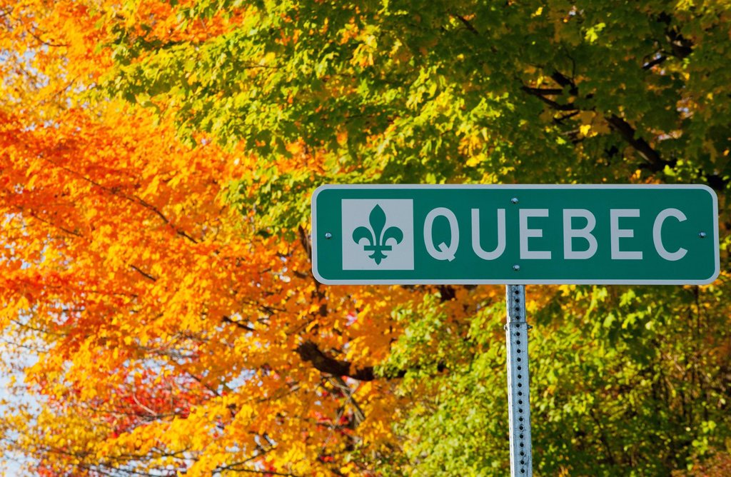 Stock Photo: 1889R-71945 a quebec sign and trees in autumn colours, abercorn quebec canada