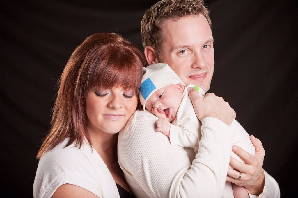 a mother and father hold a newborn baby, edmonton alberta canada : Stock Photo